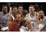con triple agonico de johnson, nets superan a nuggets