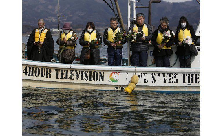Japón promete acelerar la reconstrucción tras tsunami