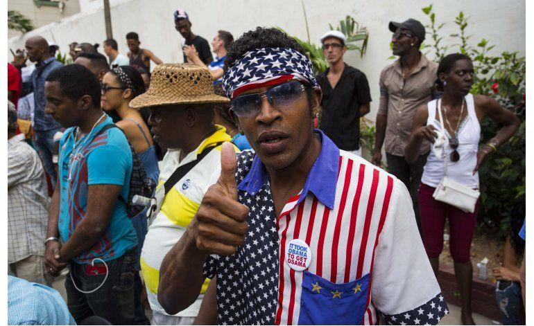 Cubanos esperan la visita de Obama, miran al futuro