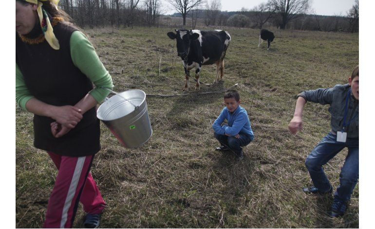 Exclusiva AP: Niños comen alimentos impuros en Chernobyl