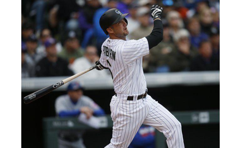 Con jonrón de Raburn, Rockies barren a Mets
