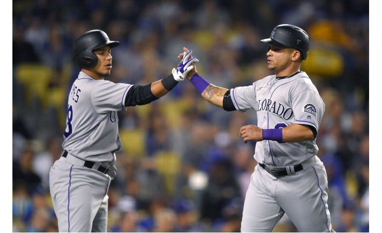 Rusin y Rockies ganan a Dodgers, que no pasan de 4 hits