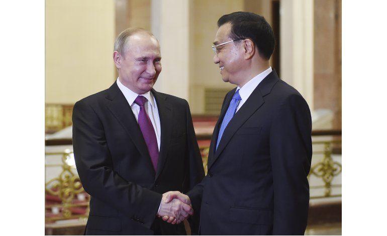 Presidente de Rusia se reúne con miembros del gobierno chino