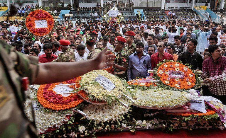 Bangladesh: Repatrían cuerpos a Japón, Daca busca pruebas
