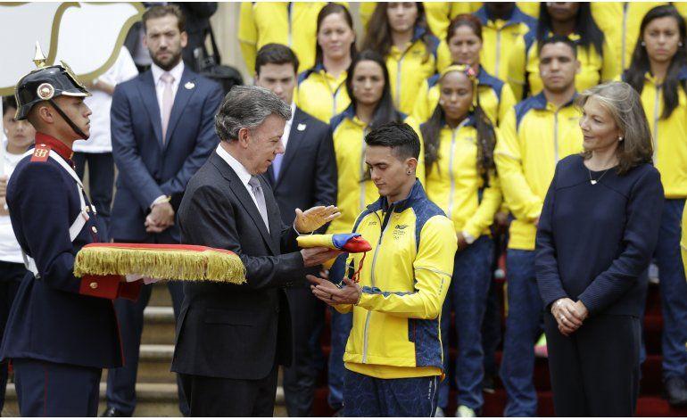 Presidente de Colombia abandera a delegación olímpica