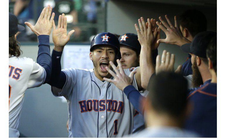 Correa, Springer lideran a Astros ante Marineros 7-3