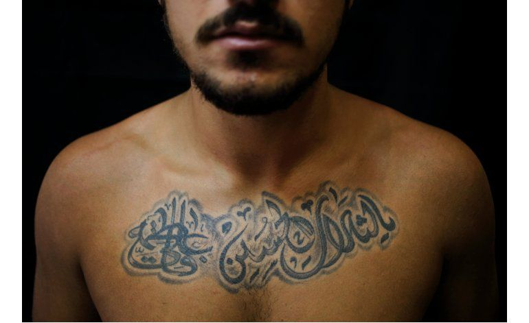 Tatuajes chiíes muestran orgullo ante tensiones