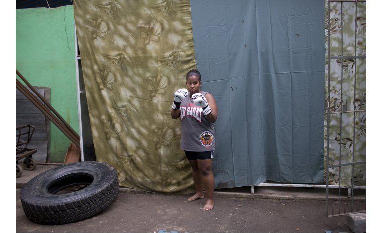 Los olímpicos, muy lejos de la favela Ciudad de Dios