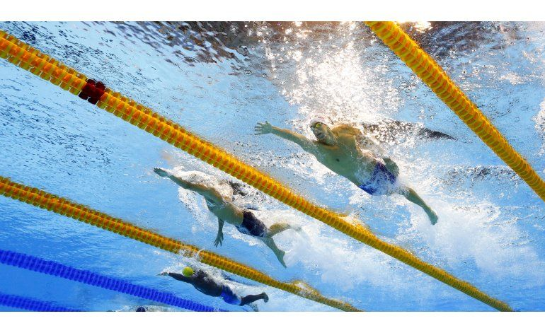 Phelps brilla en eliminatorias; Ledecky va por su 3er oro