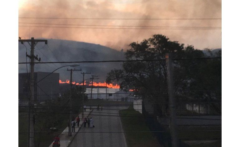 Incendio cerca de sedes olímpicas provoca lluvia de ceniza