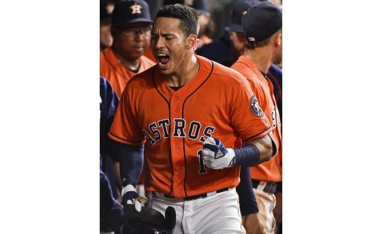 Jonrones de Correa y Gattis completan remontada de Astros