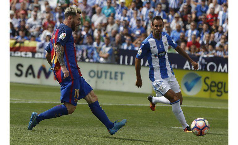 Barcelona y Atlético golean al Leganés y Sporting