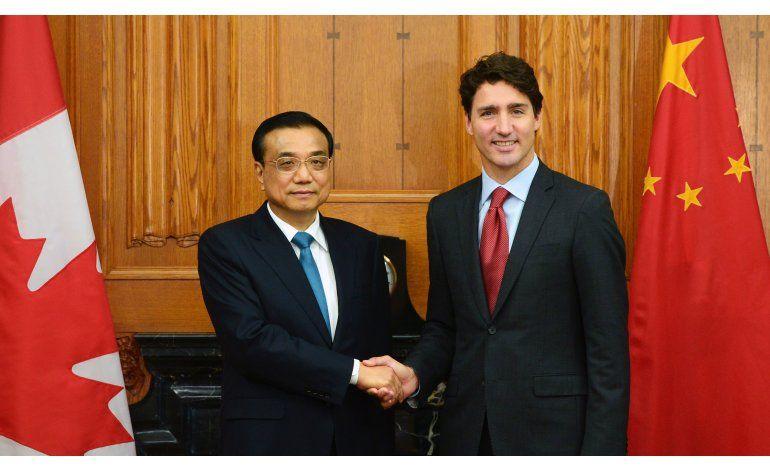 Canadá y China consideran negociar pacto de libre comercio