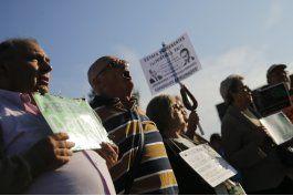 exjefe fmi llega a juicio en espana en medio de protestas