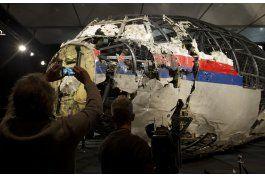 investigadores: avion malasio fue derribado por misil ruso