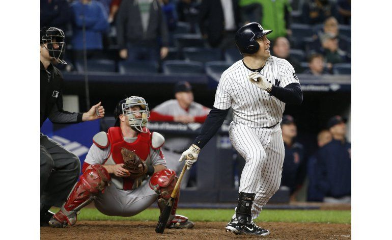 Grand slam de Teixeira decide por NY, Boston gana división