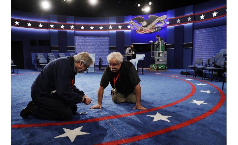 Último escándalo de Trump pende sobre el debate con Clinton