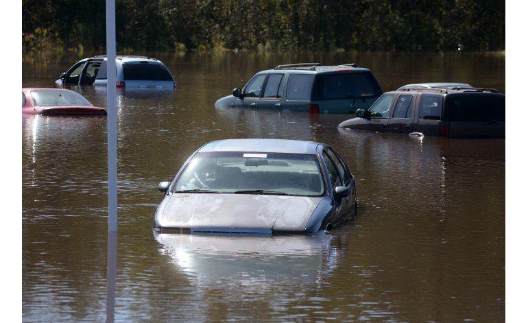 North Carolina: Río que dio vida a pueblo, ahora lo destruye