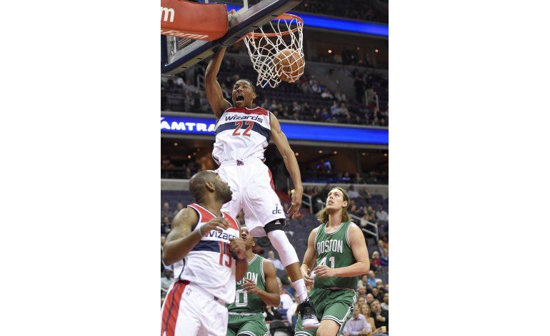 Porter anota 34, Wizards arrasan 118-93 a Celtics