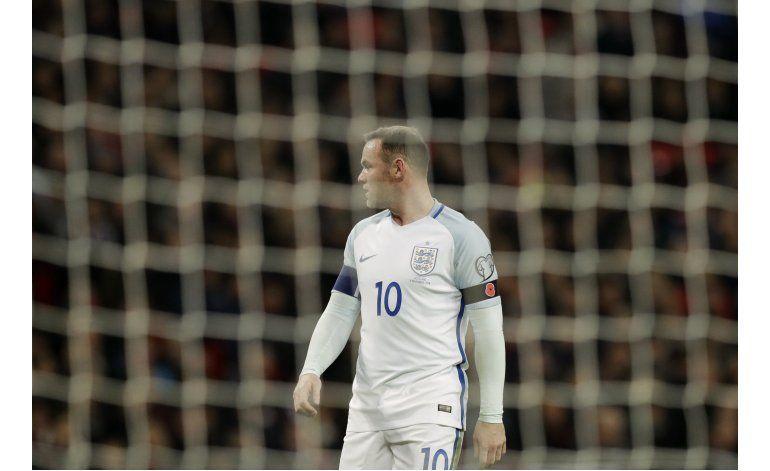 Rooney se disculpa por foto con ojos rojos