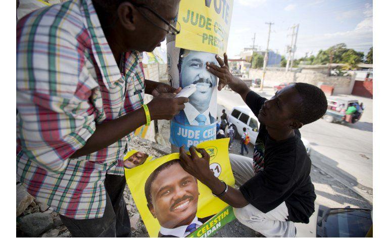 Divididos y azotados por huracán, haitianos van a las urnas