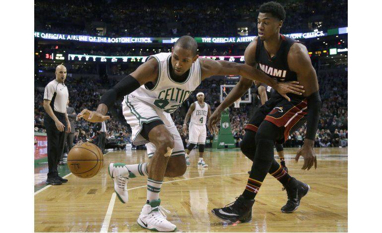 Thomas encesta 52 puntos y Celtics vencen 117-114 al Heat