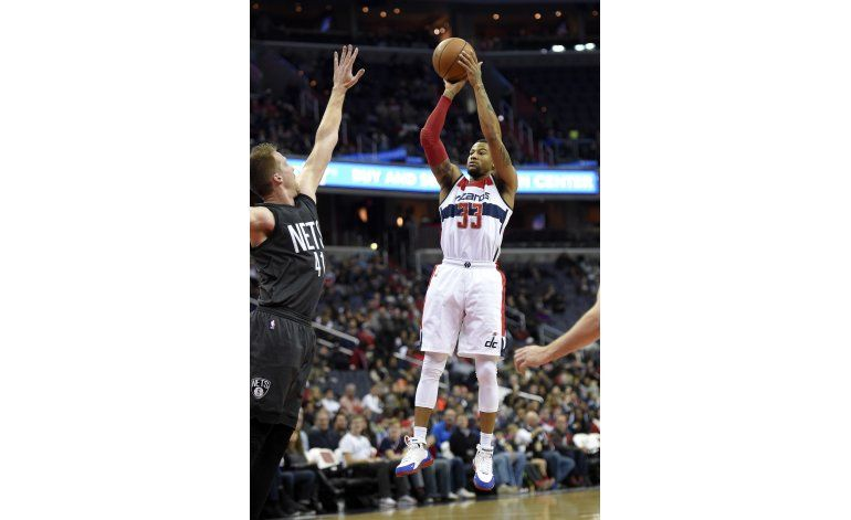Burke anota 27 y Wizards ganan 118-95 a Nets