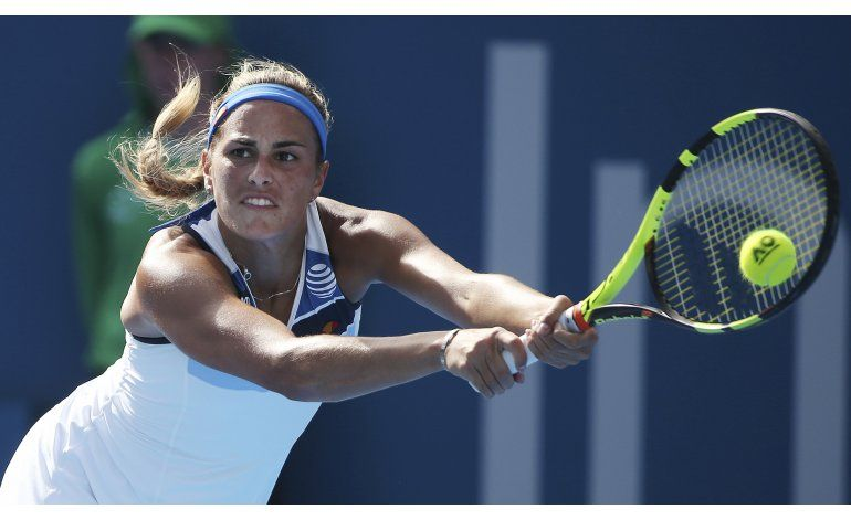 Wozniacki elimina a campeona olímpica Mónica Puig en Sydney