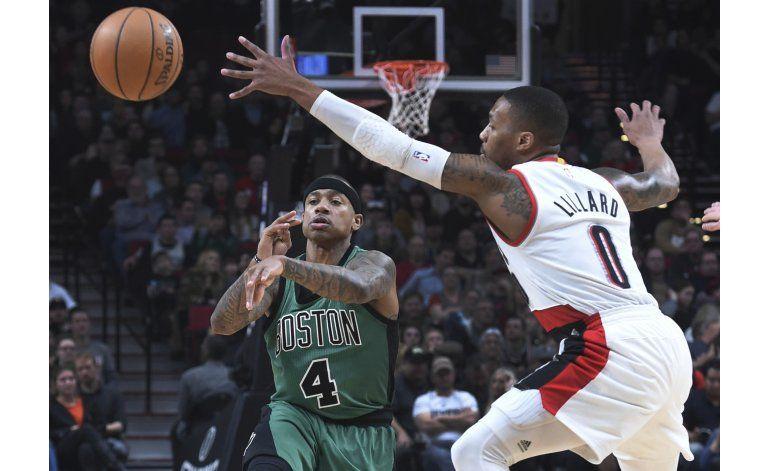 Thomas anota 34 y los Celtics vencen en Portland 120-111