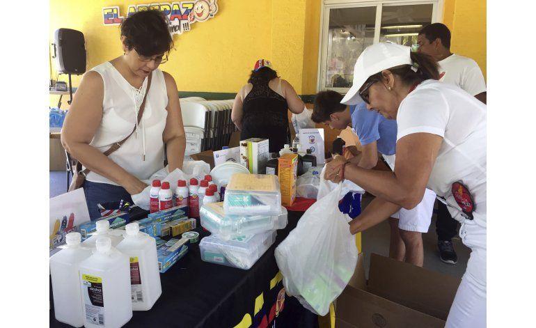 Venezolanos libran obstáculos para recibir ayuda humanitaria