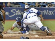 travis pega grand slam en 4to triunfo seguido de azulejos