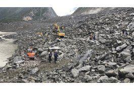 china: mas de 110 personas quedan enterradas tras deslave