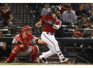 con hit de descalso, arizona vence a filis en 11 innings