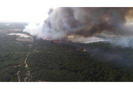 tiempo y vientos pueden ayudar contra incendio en espana