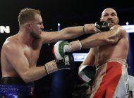 fury derrota a wallin pese a un corte sobre el ojo