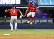 nats anotan 6 en el 10mo para vencer 10-4 a marlins