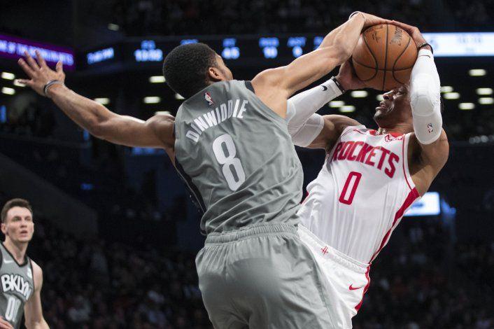Nets frenan a Harden y ganan 123-116 a Rockets