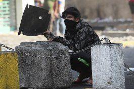 funcionarios irak: 2 fallecidos en choques en bagdad