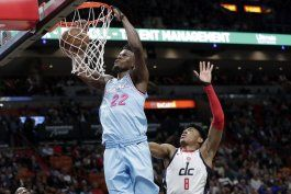 butler anota 28 puntos y heat se impone 112-103 a wizards