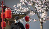 China revisa conteo de infectados, caen nuevos casos diarios