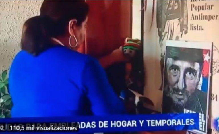 Polémica en España por imágenes de mujer limpiando retrato de Fidel Castro