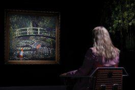 obra de banksy se subasta por casi 10 millones de dolares