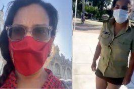 el momento en que la periodista cubana luz escobar es detenida en el parque central de la habana