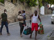 de vuelta en haiti, familia migrante planea volver a huir