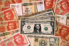 el regimen elimina el dolar en cuba en un momento critico para su economia