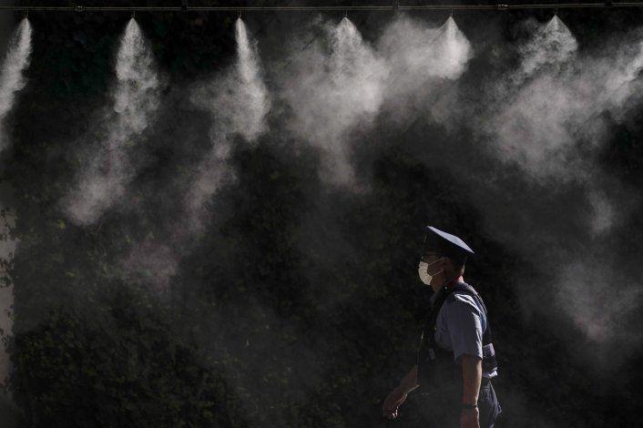 AP Fotos: Los huéspedes olímpicos miran a Tokio desde el bús