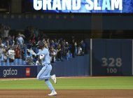 gurriel pega grand slam; azulejos ganan 11-10 a atleticos