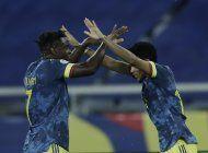 con polemica, colombia cae ante brasil pero avanza