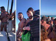 video: un grupo de personas en una playa de mexico evita que se lleven arrestada a una pareja homosexual por besarse en publico