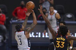 wizards superan a warriors con canasta de beal al final